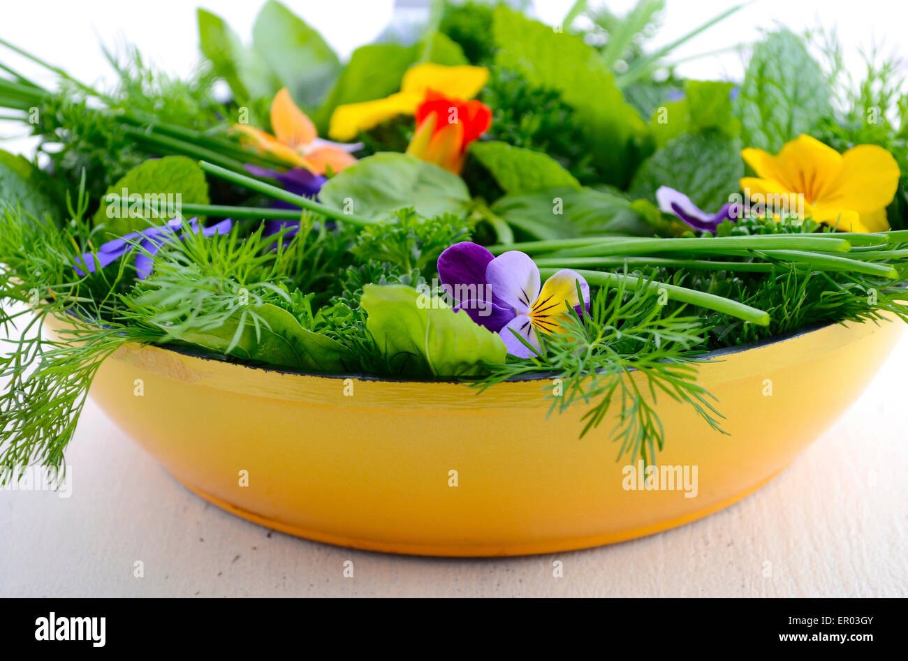 Cooking With Herbs Concept With Fresh Herbs And Edible Flowers In