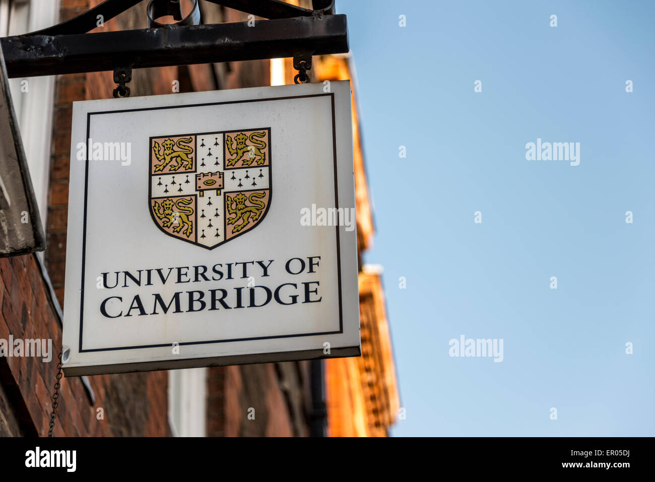 A sign displaying the coat of arms of the University of Cambridge - Stock Image