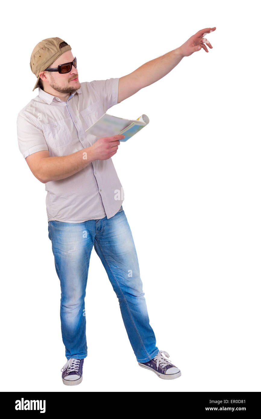 Man with guide book in a hand on white isolated background - Stock Image