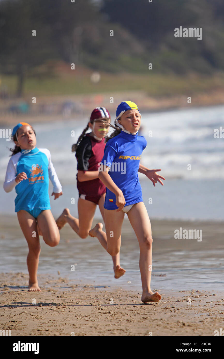 'Nippers', surf life saver training and competitions for kids. Torquay, Victoria, Australia. - Stock Image