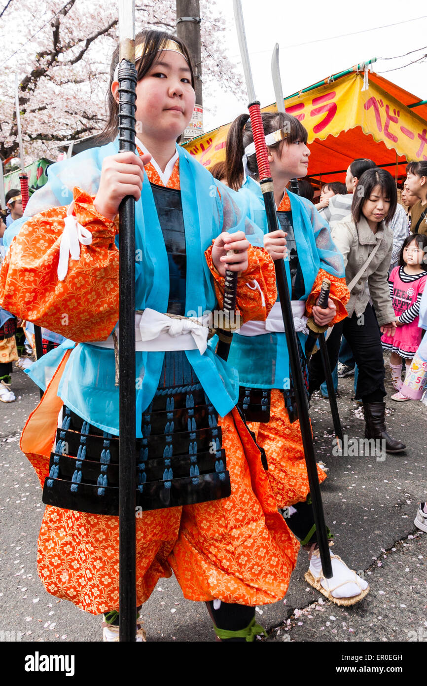 Japan, Kawanishi, Tada. Genji Festival. Marching girls dressed up as Heian ashigaru soldiers. Nearest glancing at - Stock Image