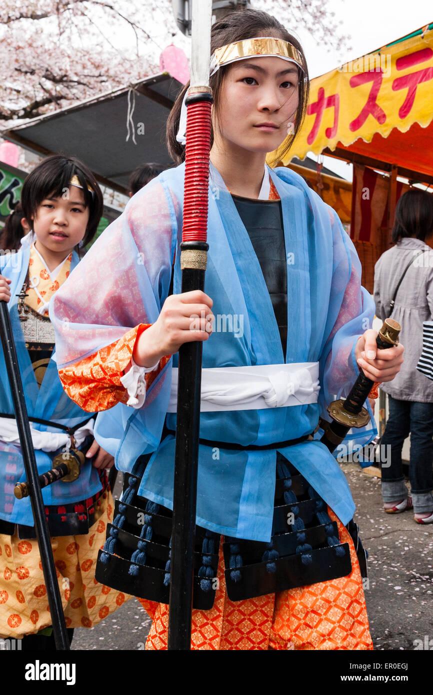 Japan, Kawanishi, Tada. Genji Festival. Girls, pre-teen, marching by in procession, dressed as Heian period Ashigaru - Stock Image