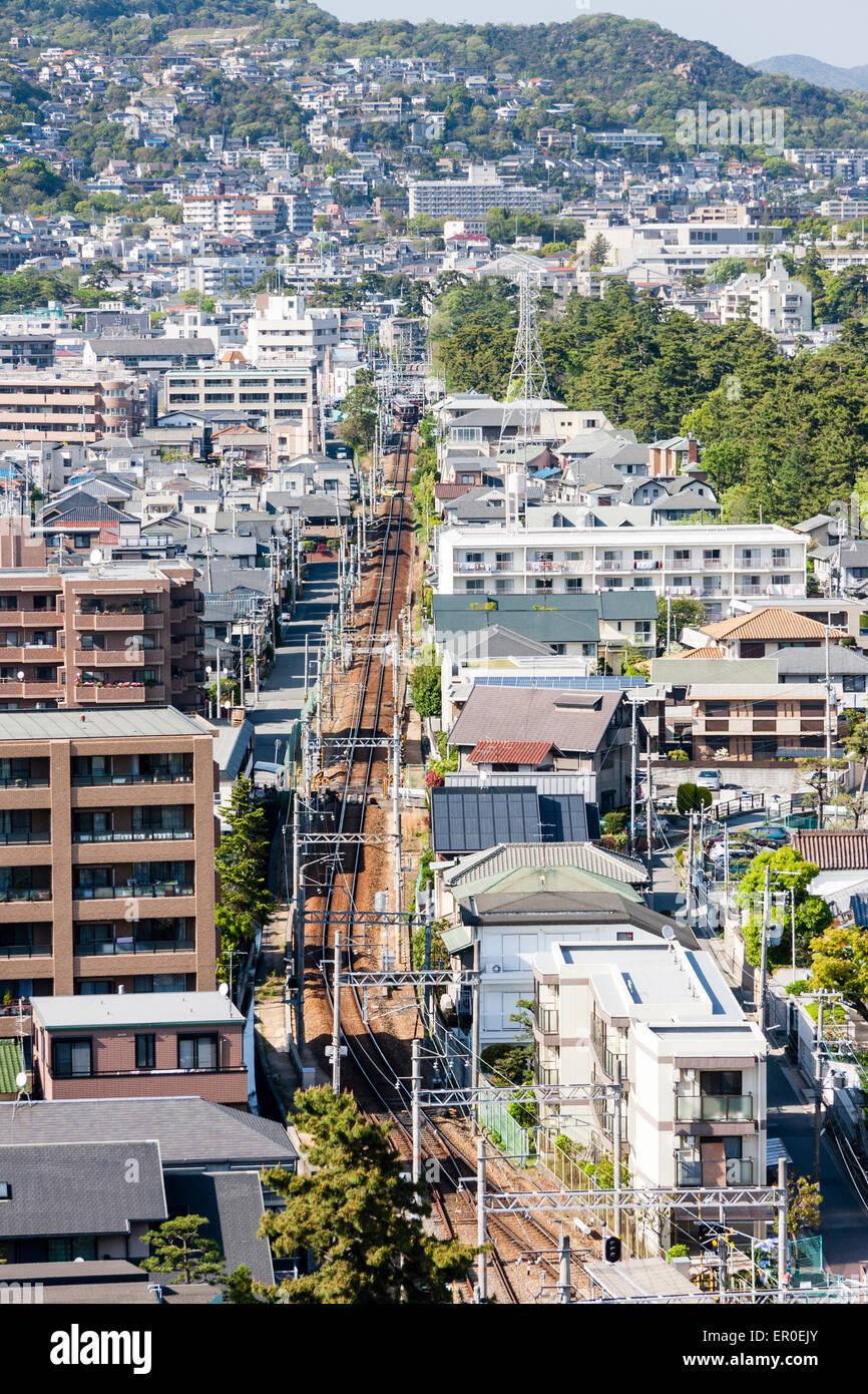 Japan, Nishinomiya, Shukugawa. Ariel view of town, following Hankyu railway line to Kurakuenguchi and Koyoen, mountains - Stock Image