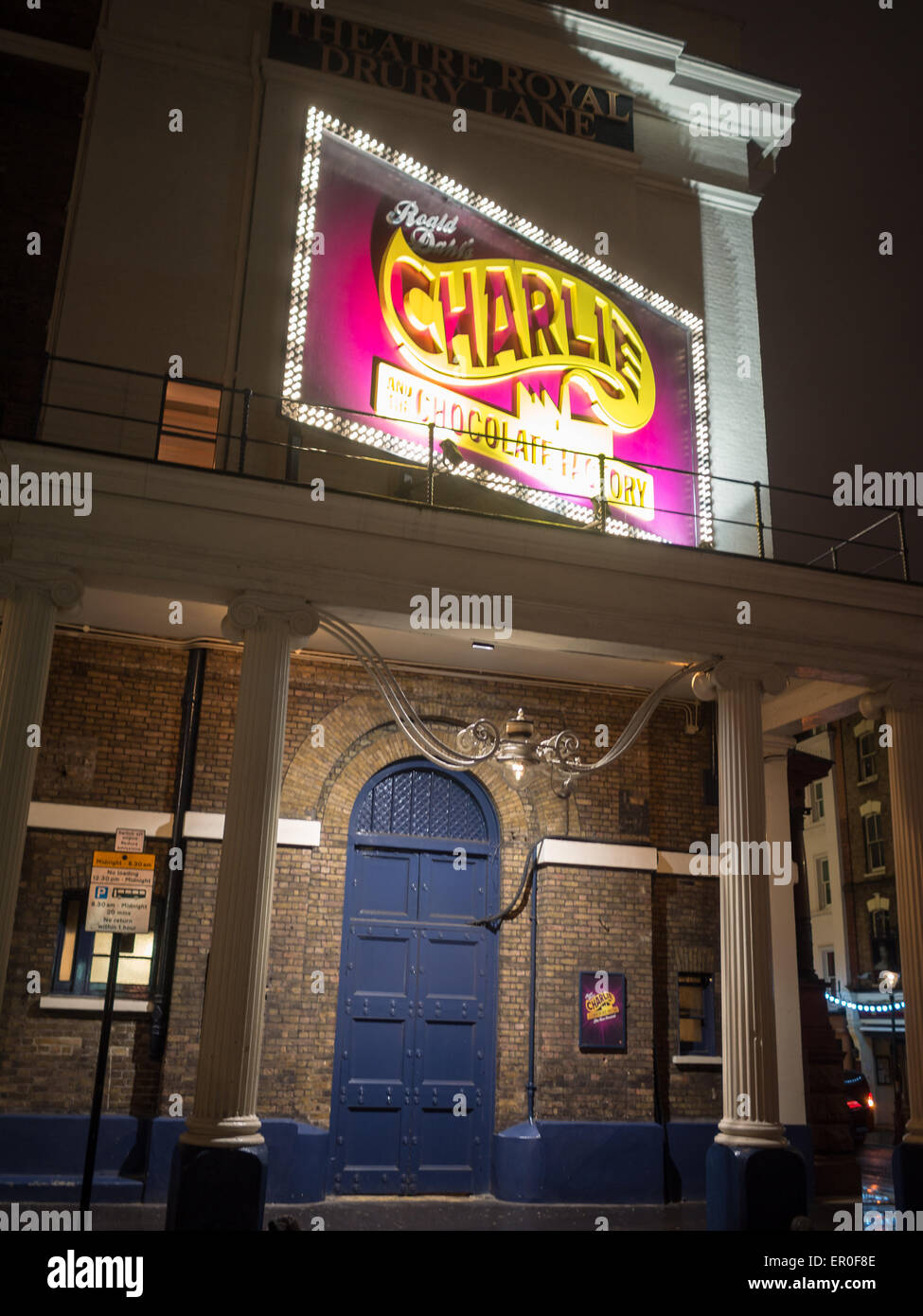 Night shot of the Charlie and the chocolate factory poster over the door of the Theater Royal Drury Lane & Night shot of the Charlie and the chocolate factory poster over the ...