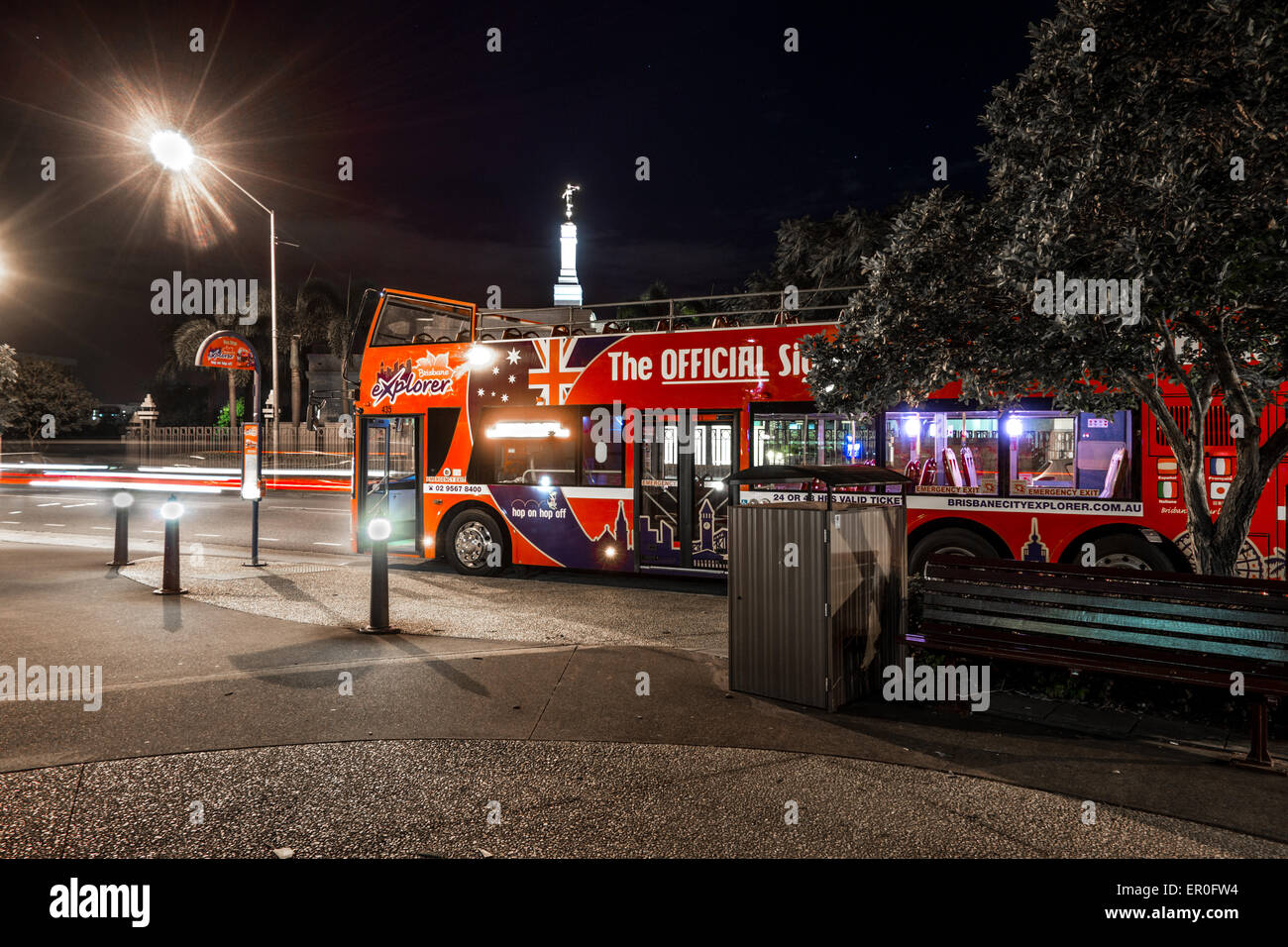 Brisbane Explorer Bus at Night with Light Trails - Stock Image