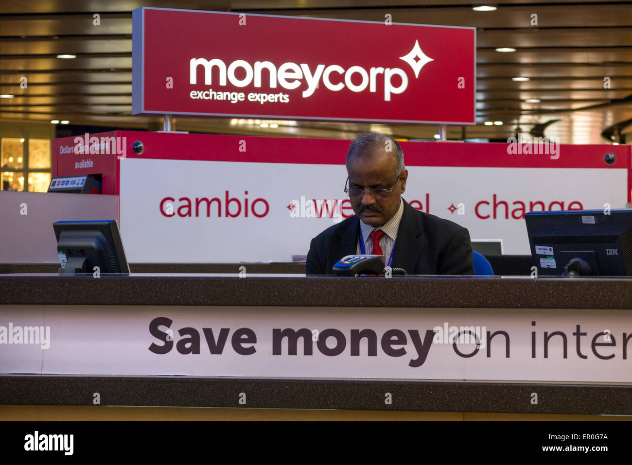 Bureau de Change office operated by Moneycorp; Terminal 3 / three at London Heathrow airport. UK. Stock Photo