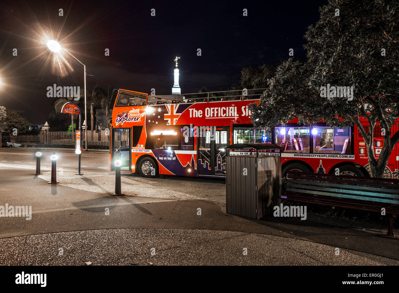 Brisbane Explorer Bus at Night - Stock Image
