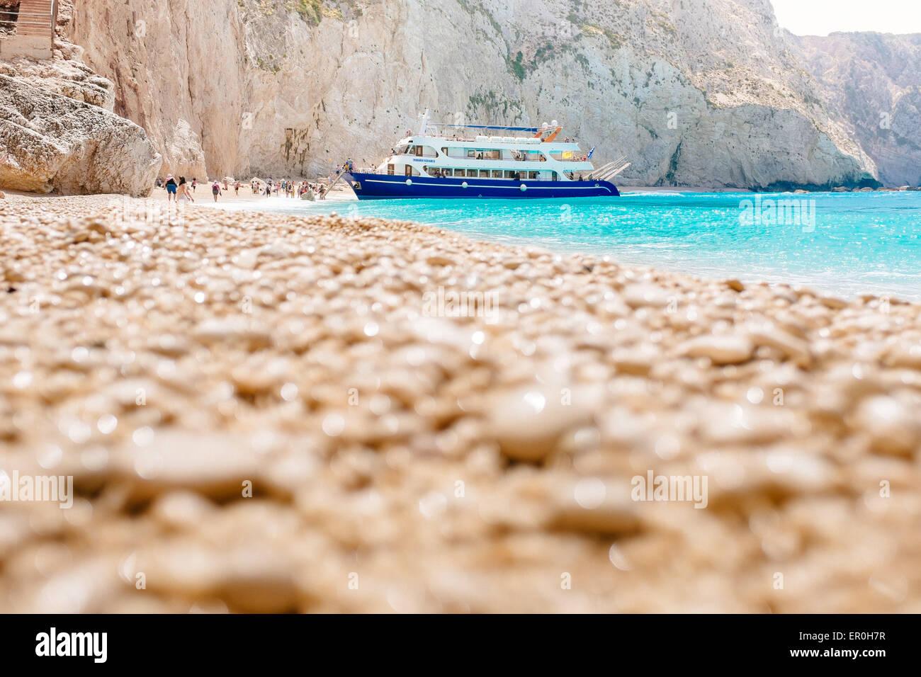Porto Katsiki beach with tourist ship, Lefkada island, Greece - Stock Image