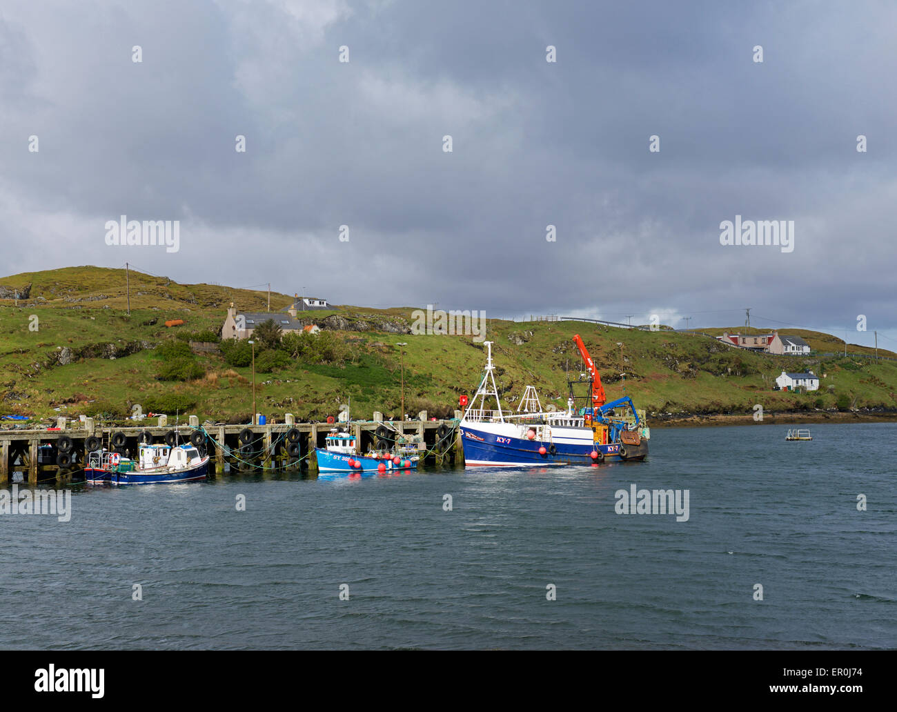 Boats at the pier on the island of Scalpay, Harris, Outer Hebrides, Scotland UK - Stock Image