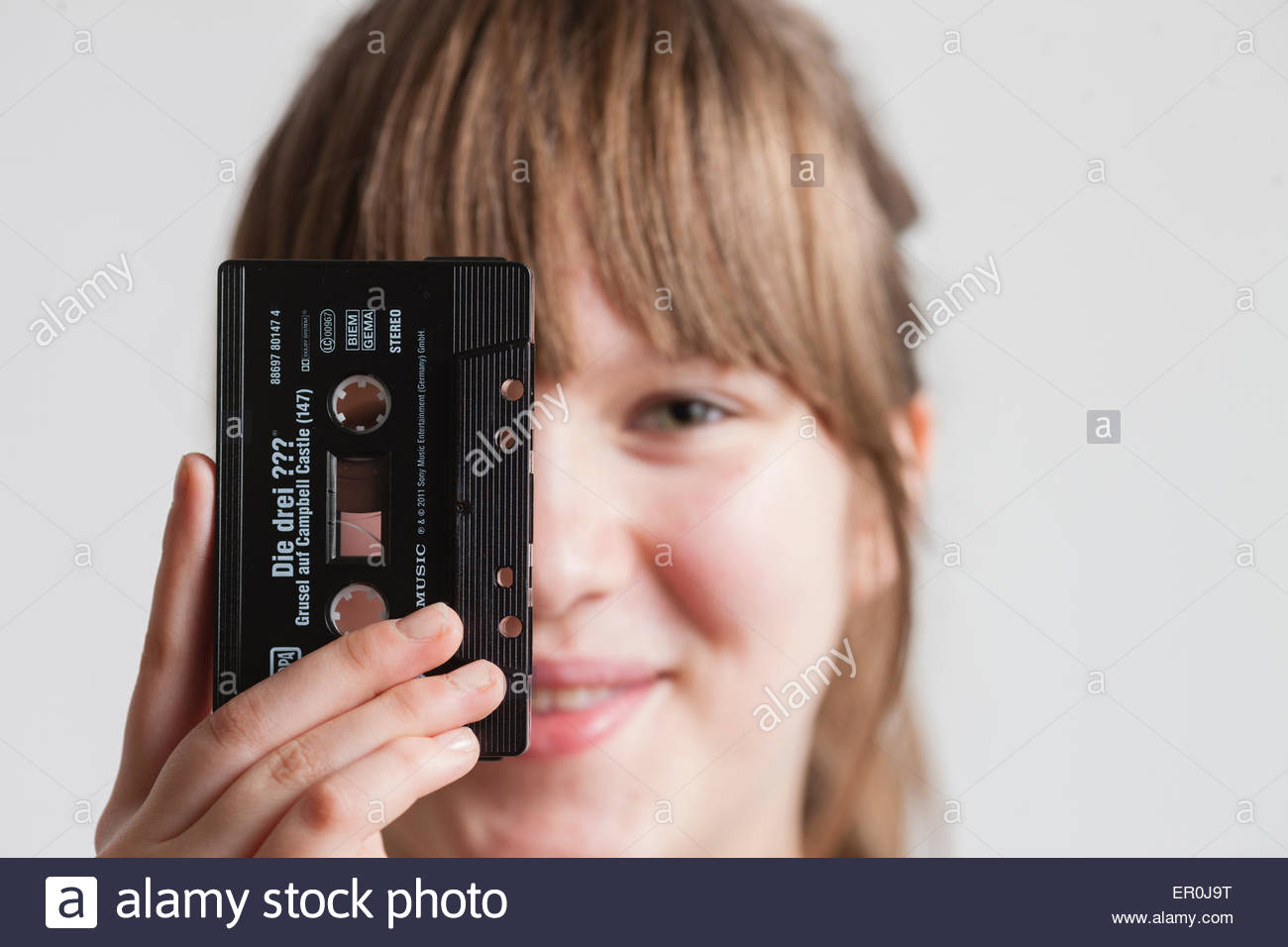girl with audiocassette - Stock Image