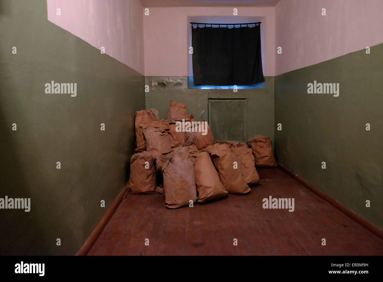 Piles of straw for straw mattresses in a cell at the former KGB prison now the museum of Genocide Victims in the - Stock Image