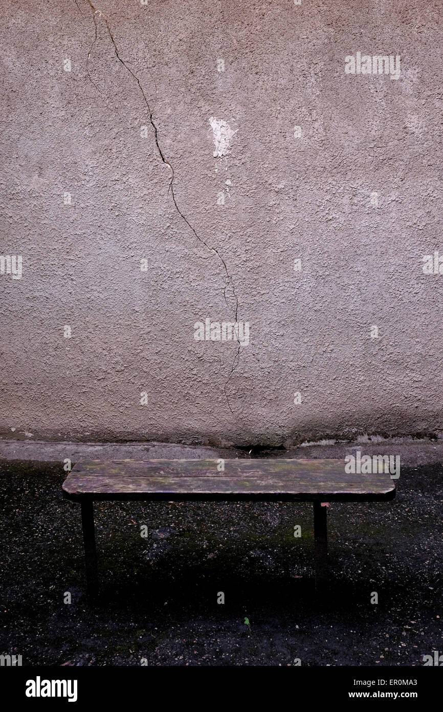 A bench at an ordinary outdoor cell at the former KGB prison now the museum of Genocide Victims in the city of Vilnius - Stock Image