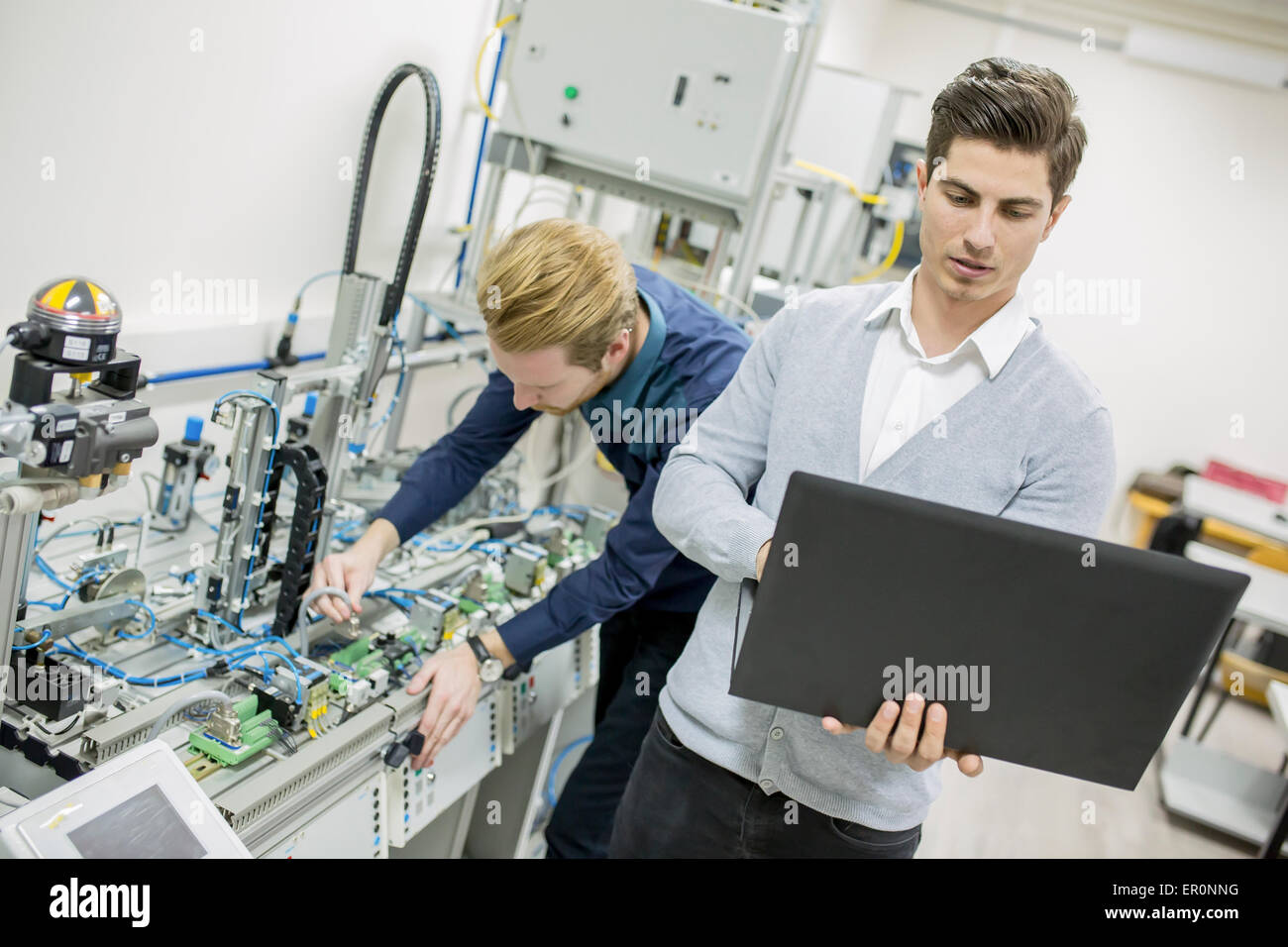 Engineers in the factory - Stock Image
