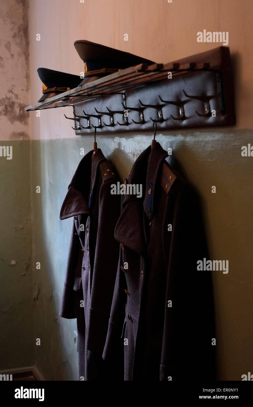 Soviet military uniforms on display at the former KGB prison now the museum of Genocide Victims in the city of Vilnius - Stock Image