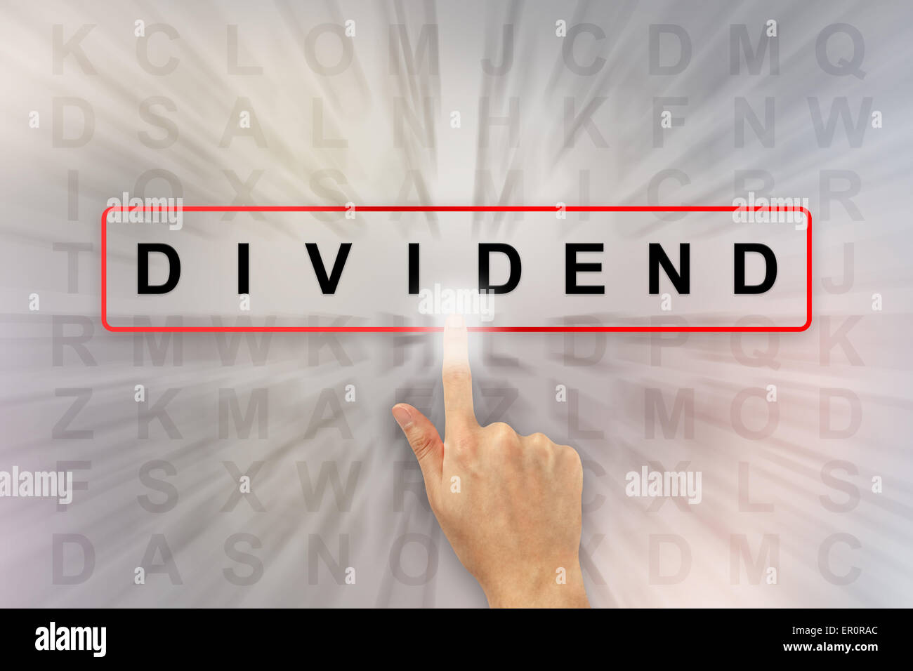 hand clicking dividend on word search puzzle - Stock Image