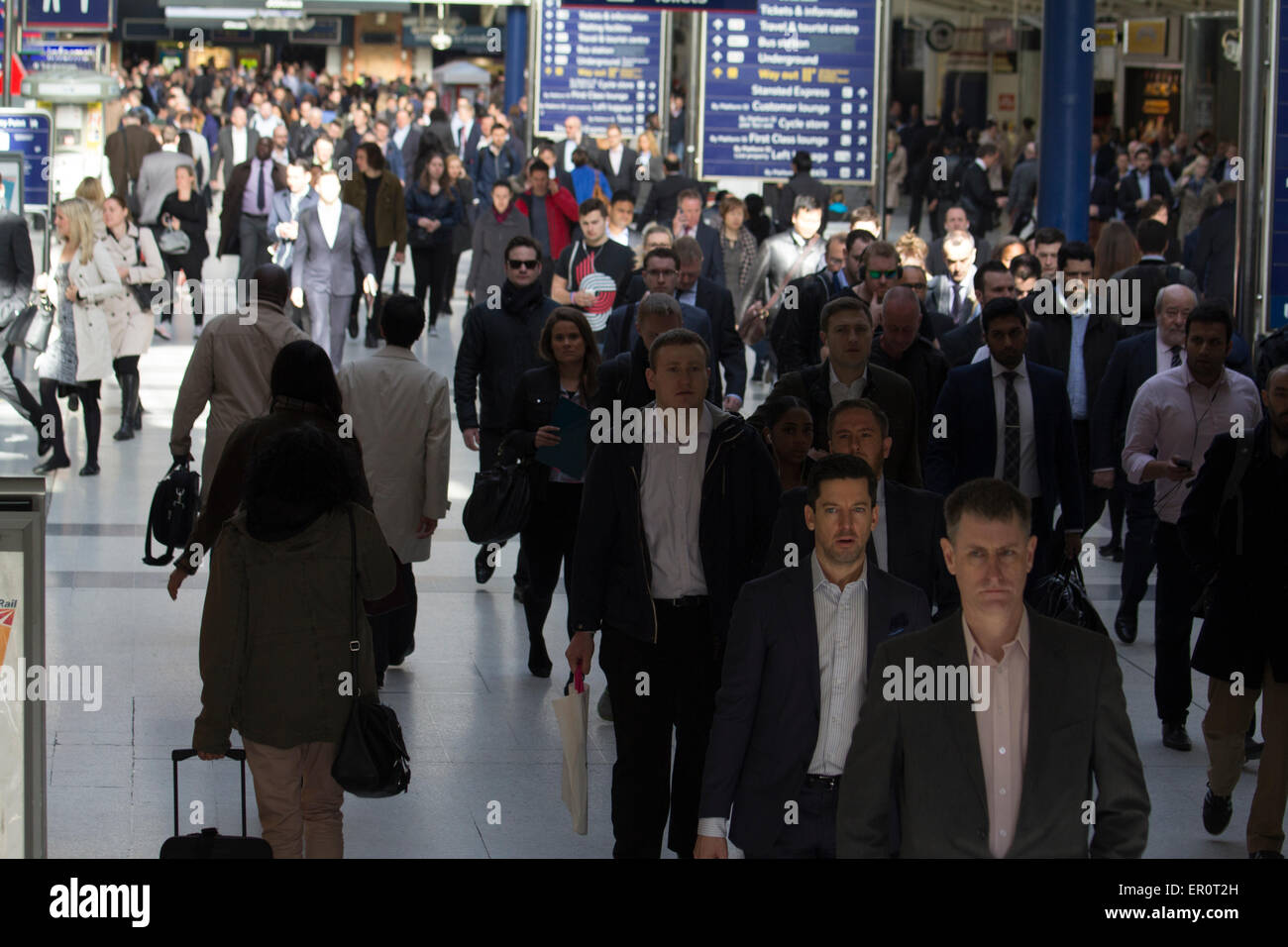 crowds of morning rush hour commuters Liverpool street London - Stock Image