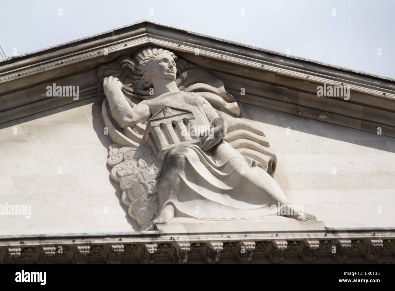 Bank of England architectural feature on roof apex, lady of the bank, Threadneedle street London - Stock Image