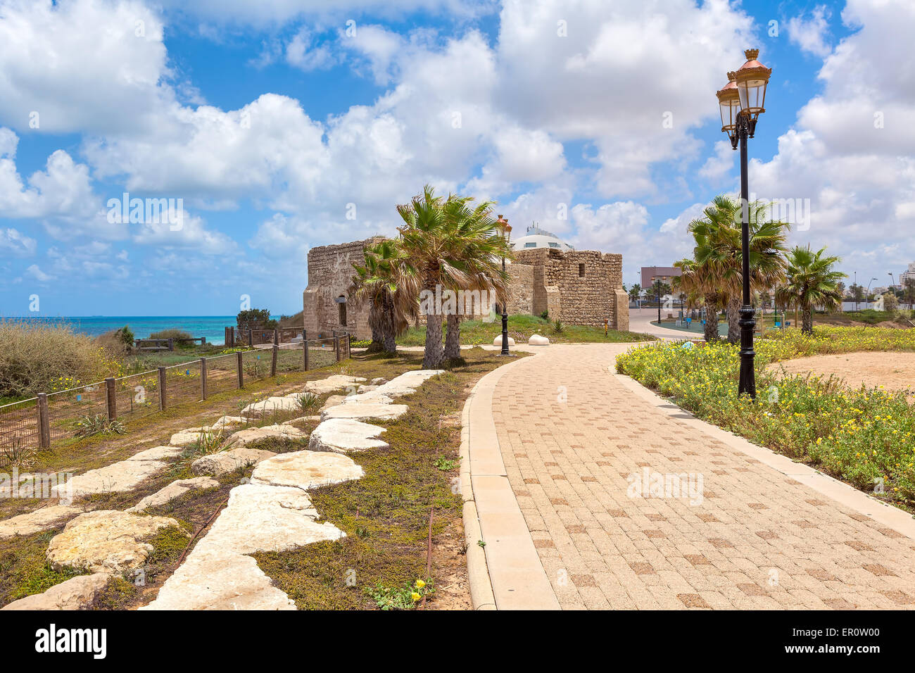 Pedestrian walkway, lampposts and ancient on promenade along Mediterranean sea coastline in Ashqelon, Israel. - Stock Image