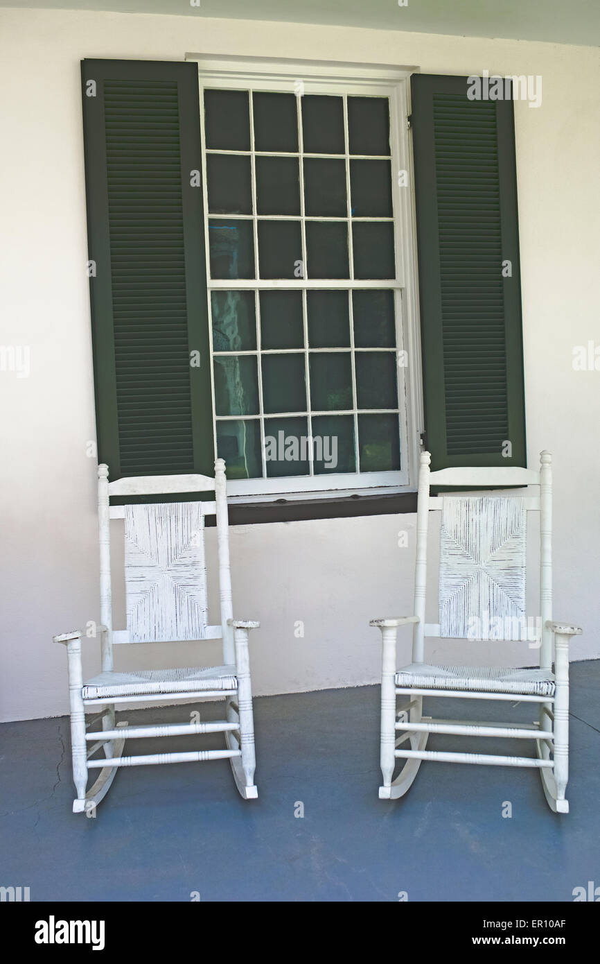 A pair of white antique rocking chairs await visitors to Melrose, an Old South antebellum mansion in Natchez, Mississippi, - Stock Image