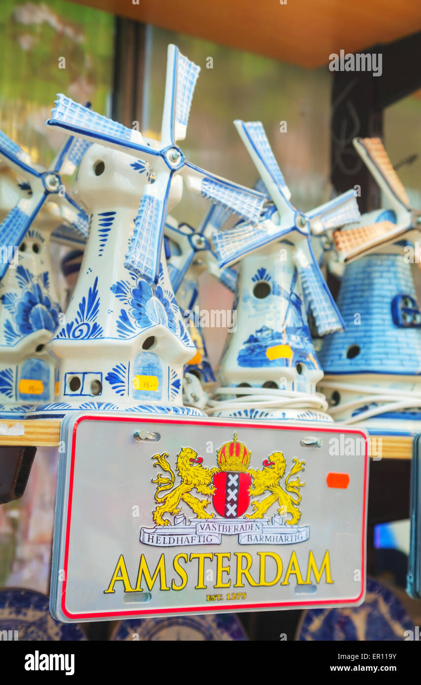 AMSTERDAM - APRIL 17: Wind mill souvenirs at the floating flower market shop on April 17, 2015 in Amsterdam, Netherlands. - Stock Image