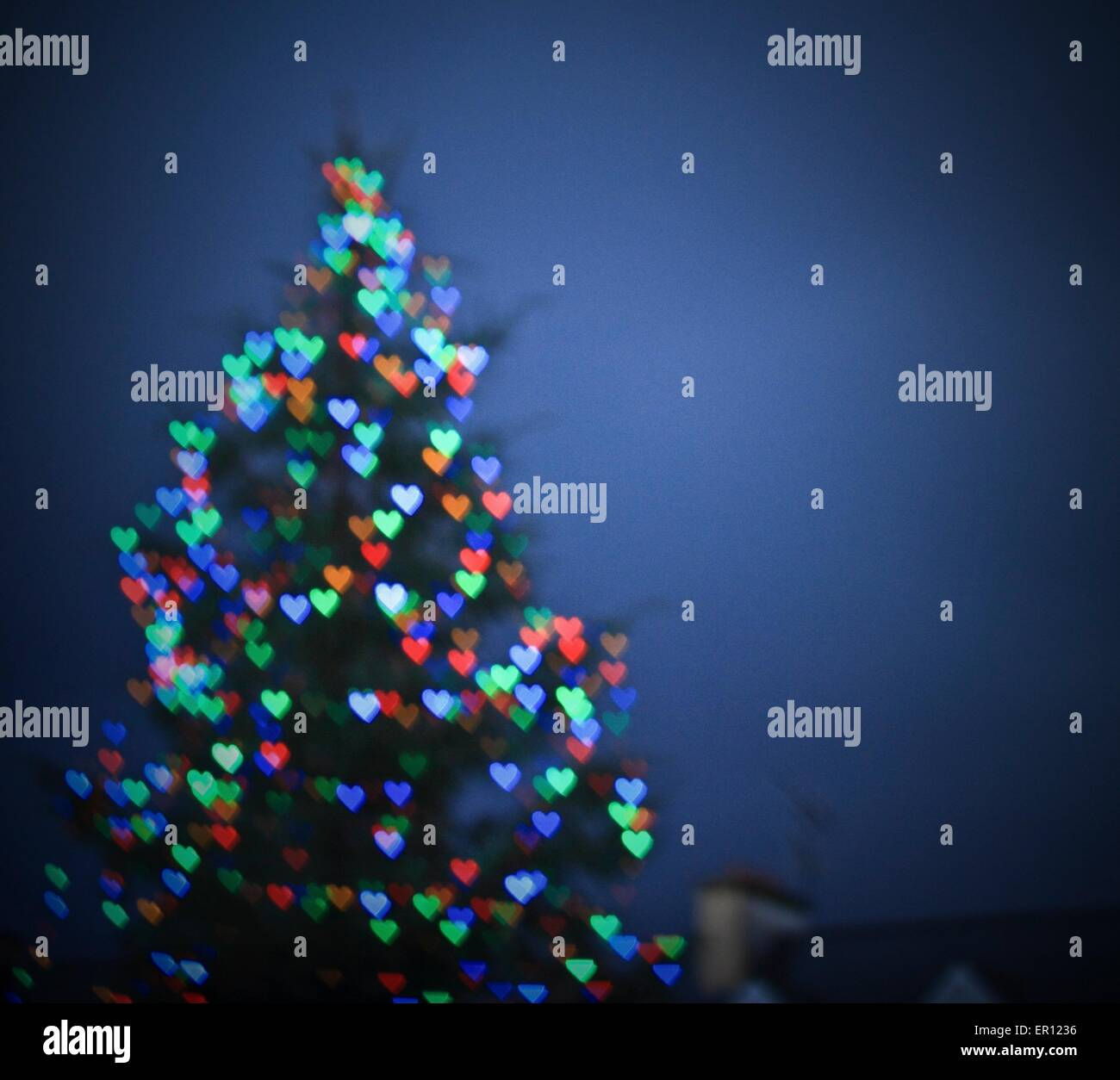 Blurry Christmas Tree With Bokeh Heart Shaped Lights