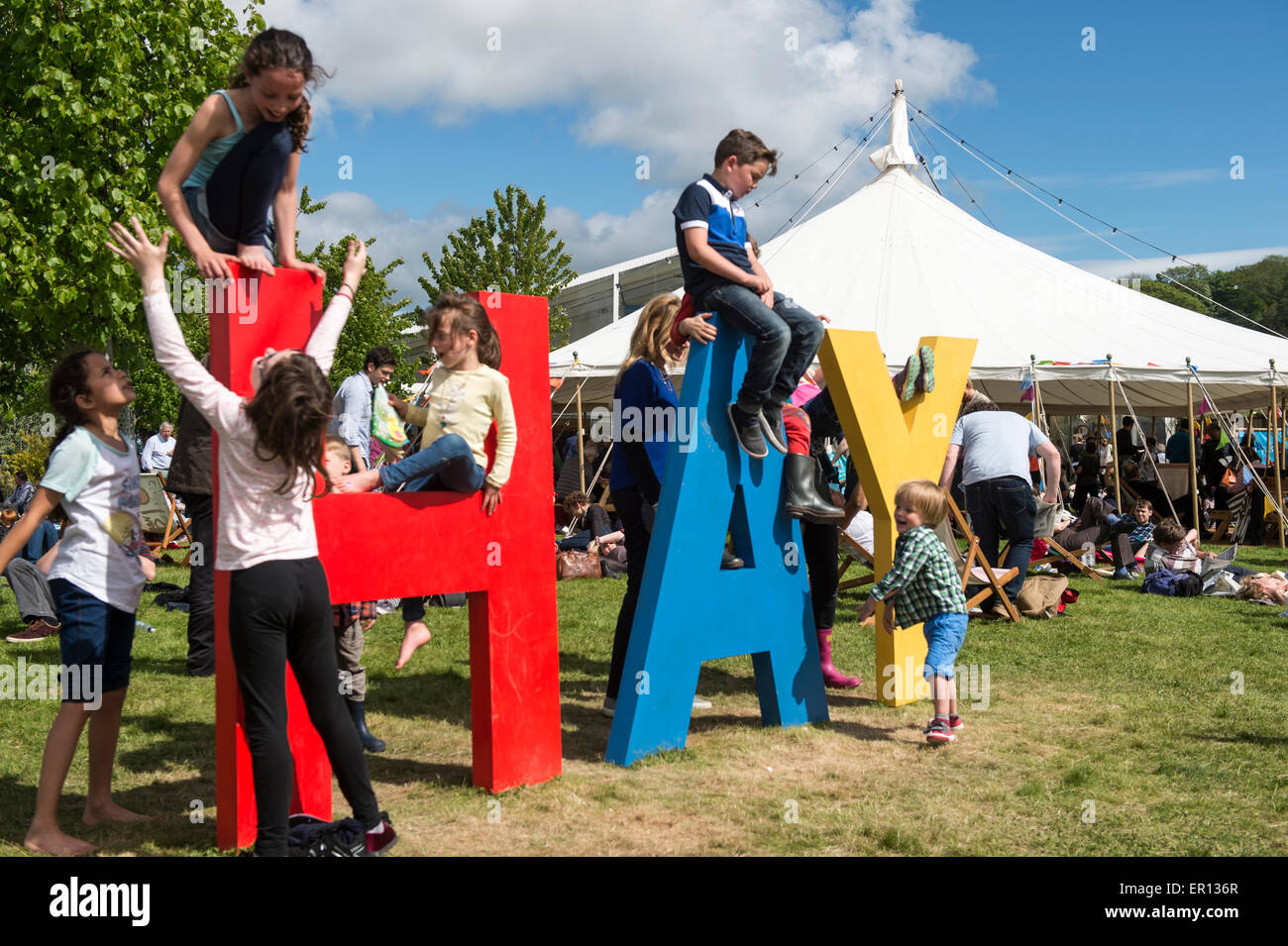 Hay-on-Wye, Wales, UK. 24th May, 2015. Children play on a sign at the Hay Festival on May 24, 2015 in Hay-on-Wye, - Stock Image