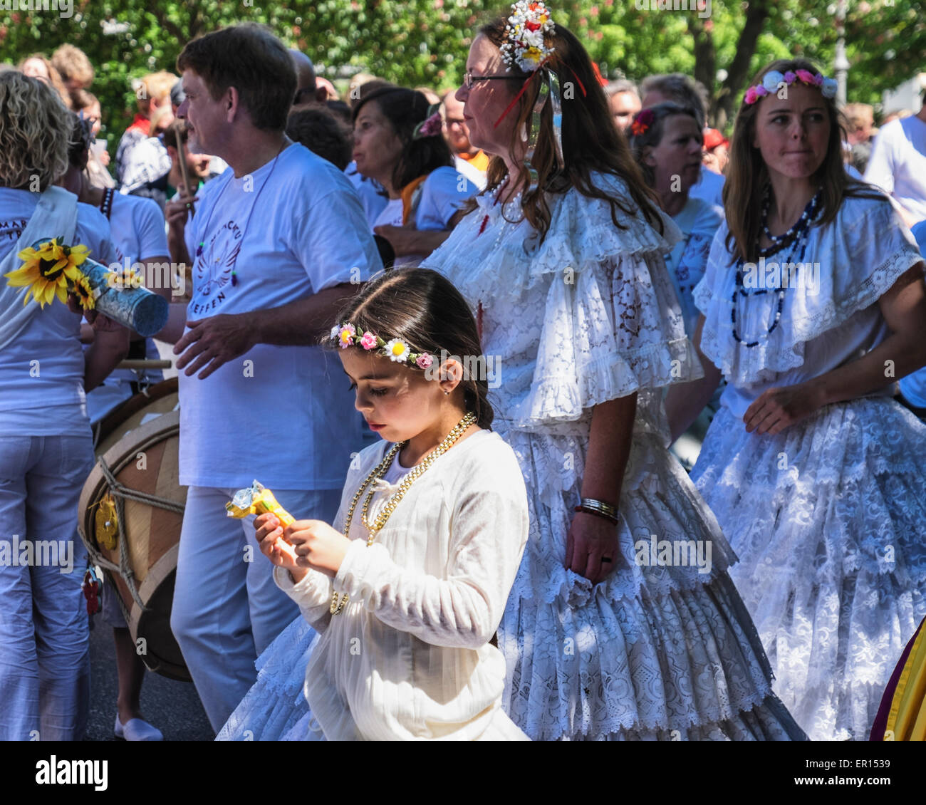 Kreuzberg, Berlin, Germany, 24th May 2015. Pretty young girl dancer in white dress and floral headband in parade - Stock Image