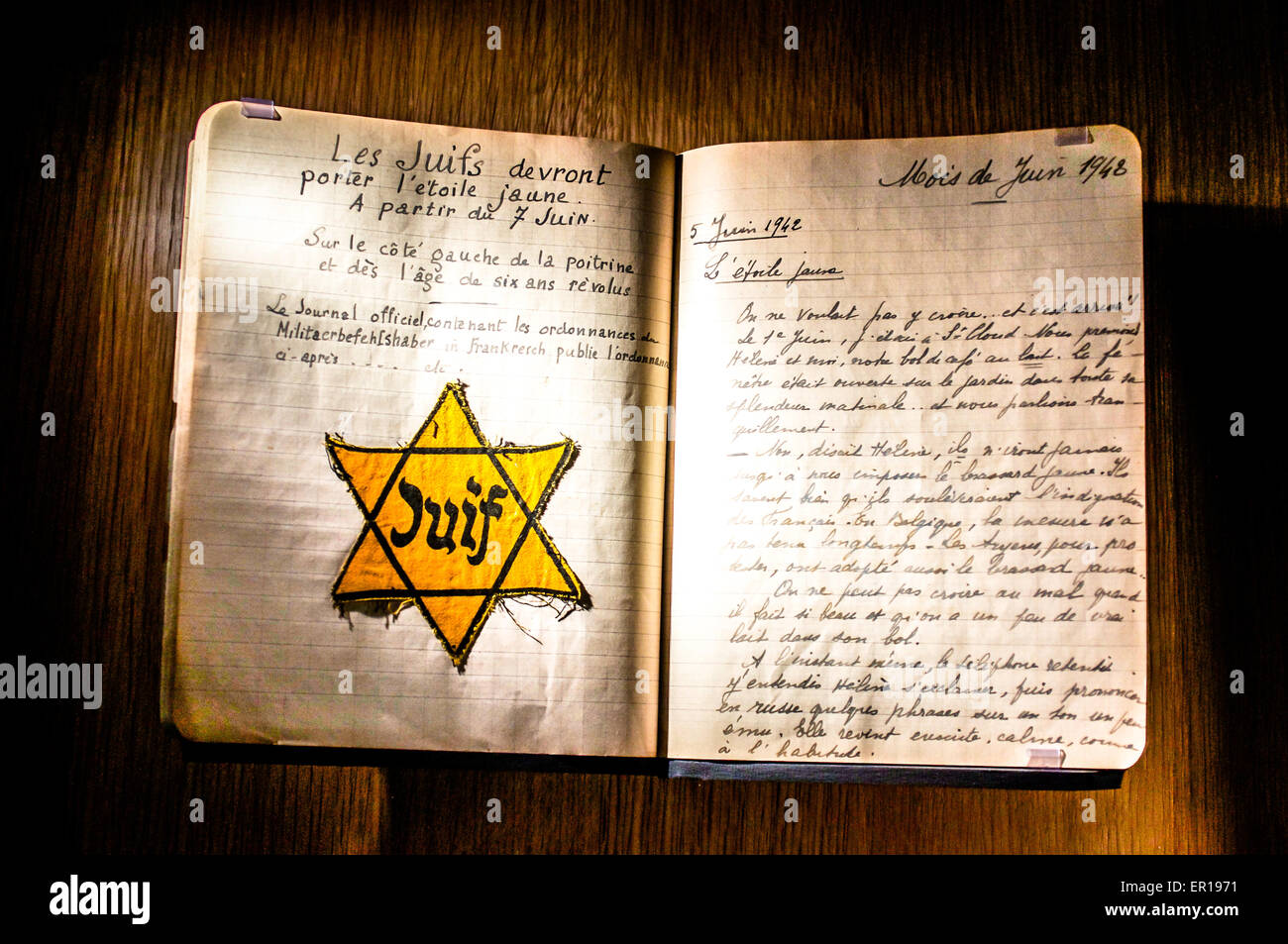 A handwritten journal from 1940s France & a yellow Jewish Star, required to be worn by all Jews in German occupied - Stock Image