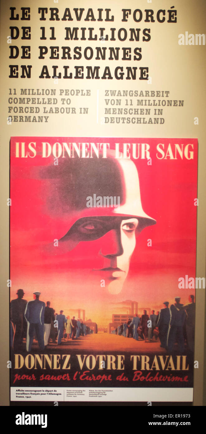 Vintage 1942 German WWII labour camp poster for French citizens who were forced to work in war industry factories - Stock Image