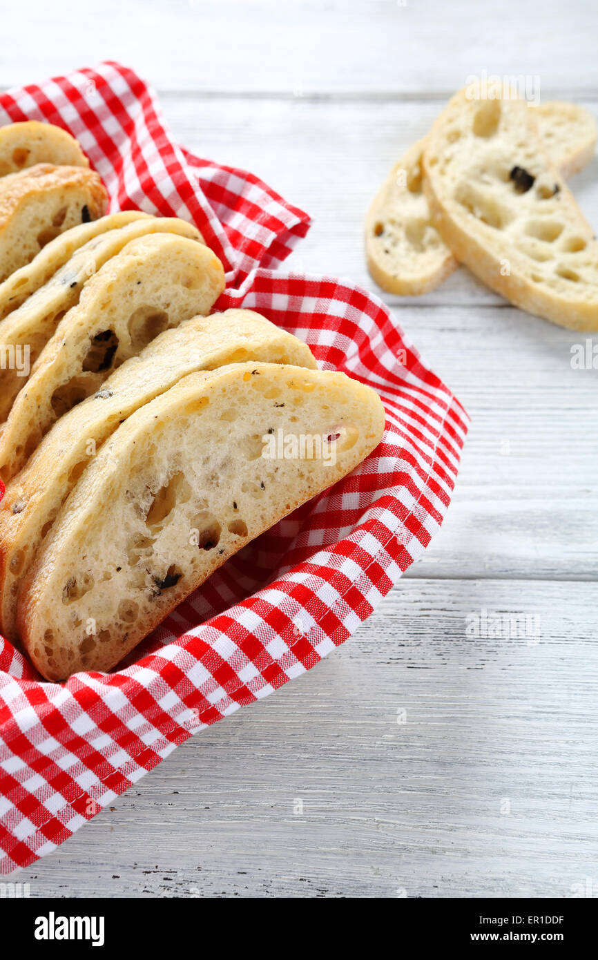 italian bread  with filling on a napkin, ciabatta - Stock Image
