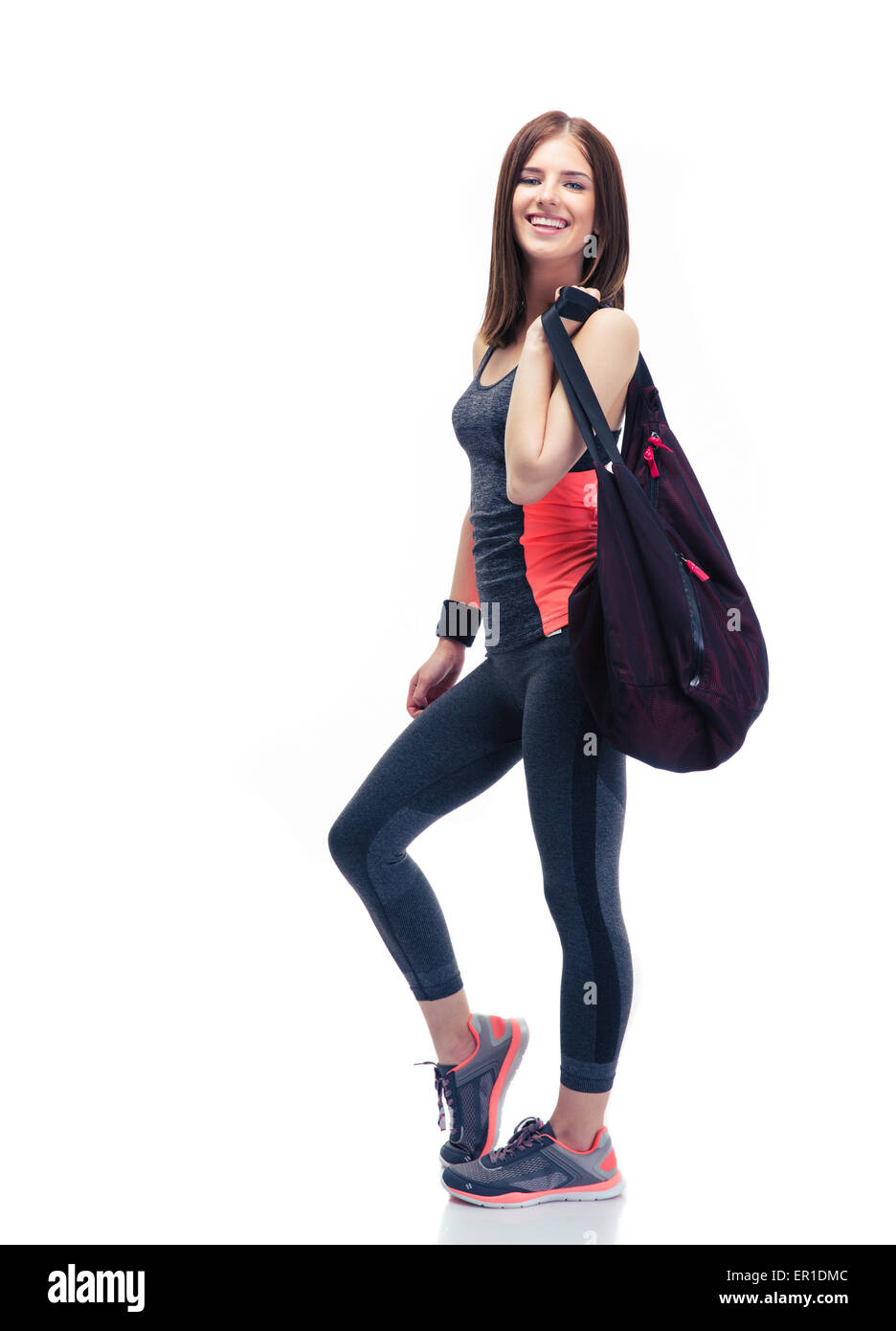 b773c8af Full length portrait of a happy woman standing with sports bag isolated on  a white background