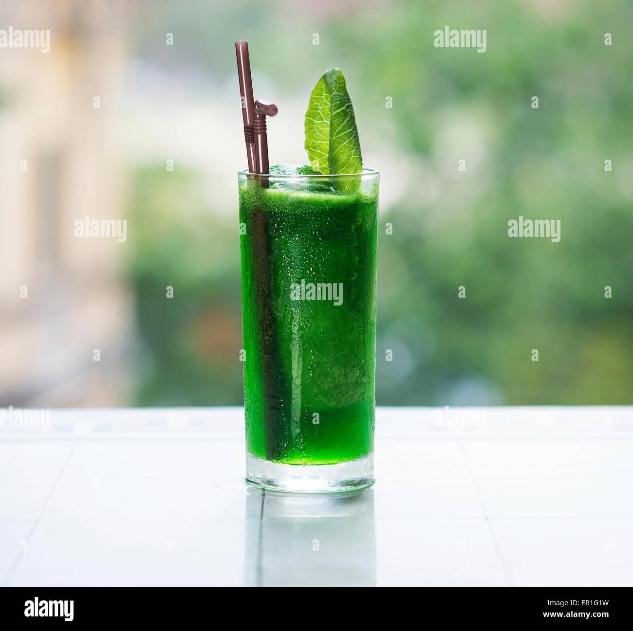 green vegetable detox juice outdoor - Stock Image