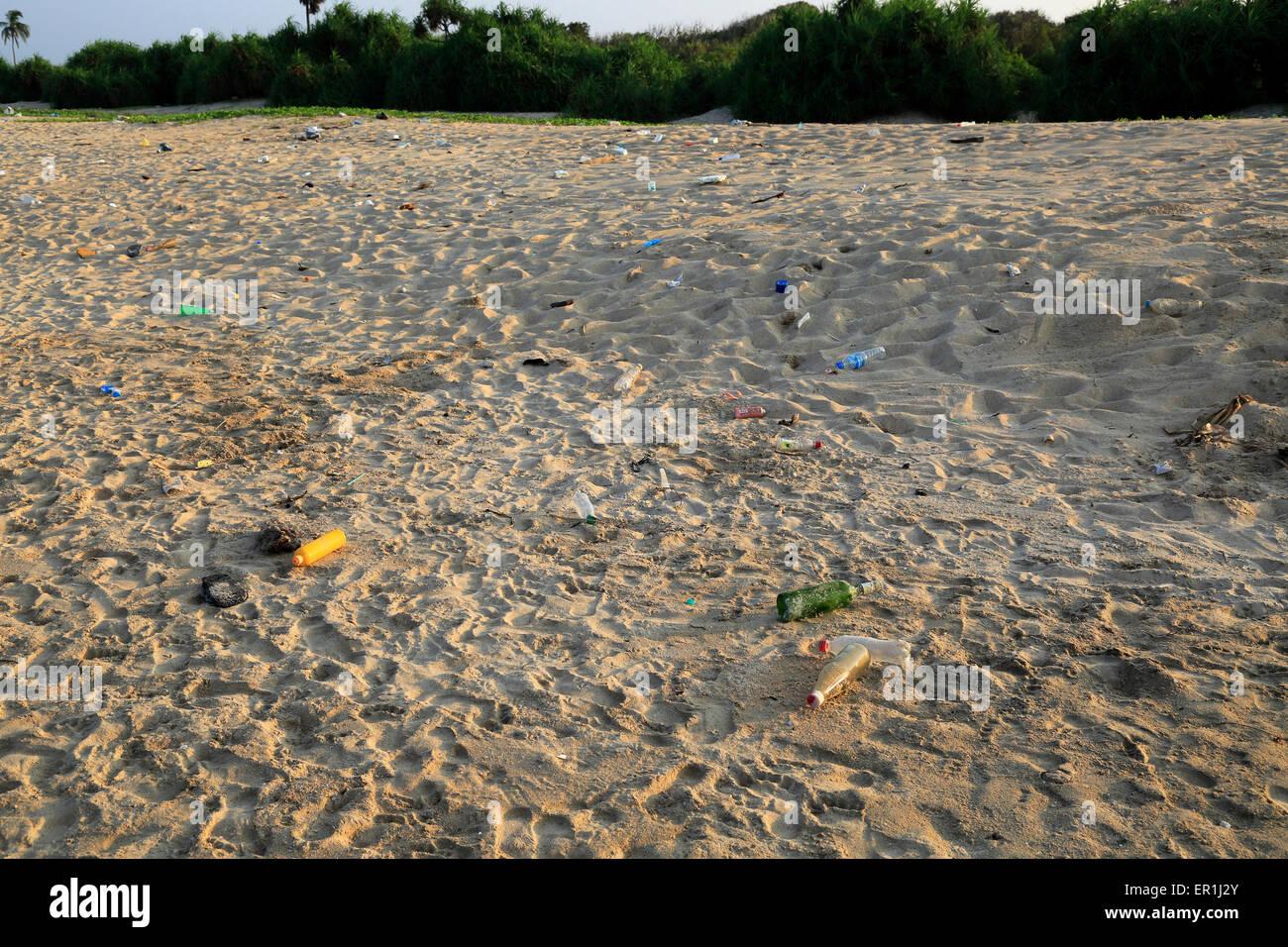 Plastic bottles litter on sandy beach, Nilavelli beach, Trincomalee, Sri Lanka, Asia - Stock Image
