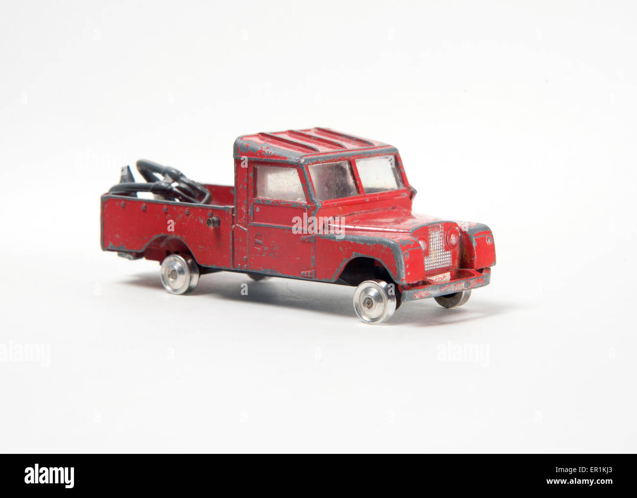 Very battered old toy car, Corgi Toys model 477, Series II Land Rover pick  up tow truck