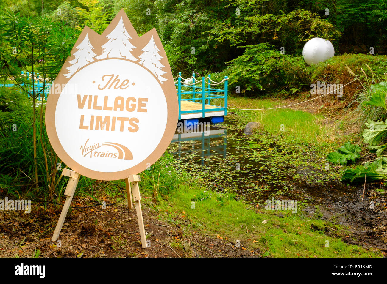 Virgin Trains sign, states 'The Village Limits' in the woods. During Festival No.6. In Portmeirion, North Wales Stock Photo
