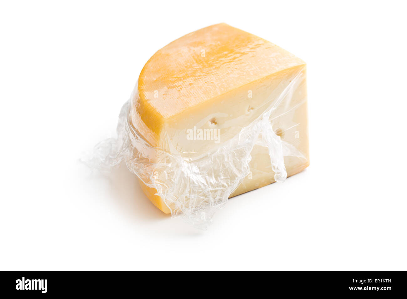 wrapped edam cheese on white background - Stock Image