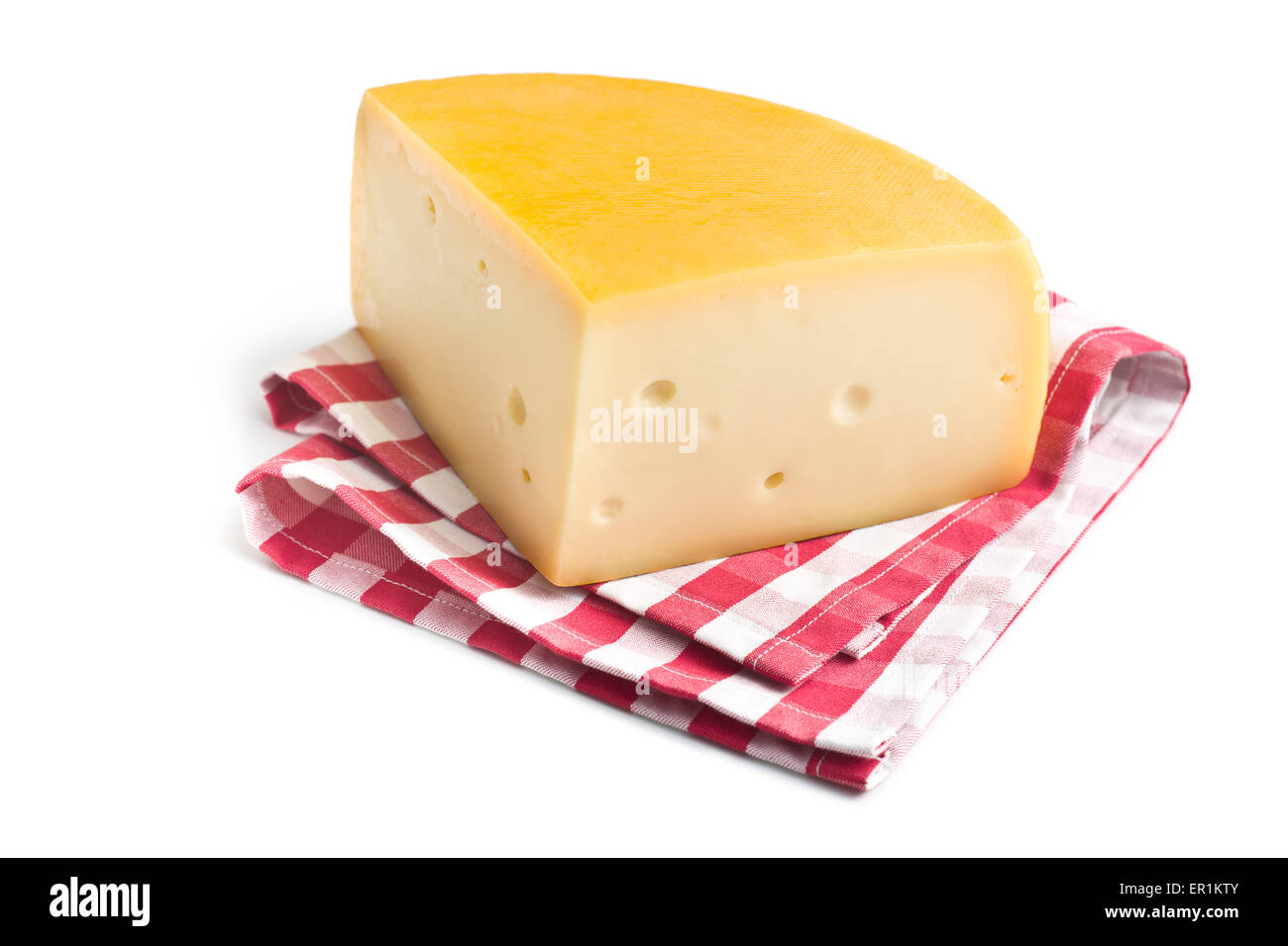 the edam cheese on checkered napkin - Stock Image