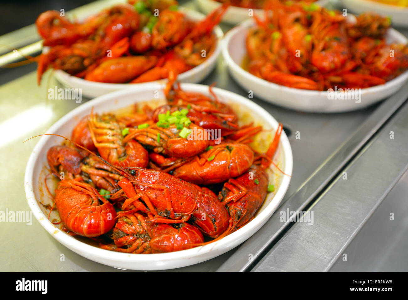 Prawns dish on display in a food market in Shanghai China. - Stock Image