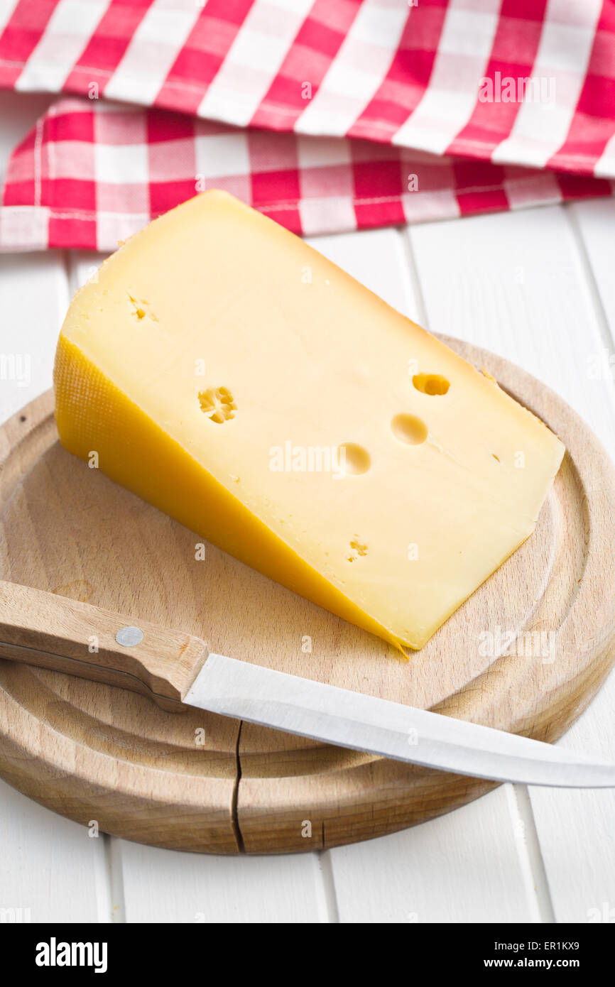 block of edam cheese on kitchen table - Stock Image