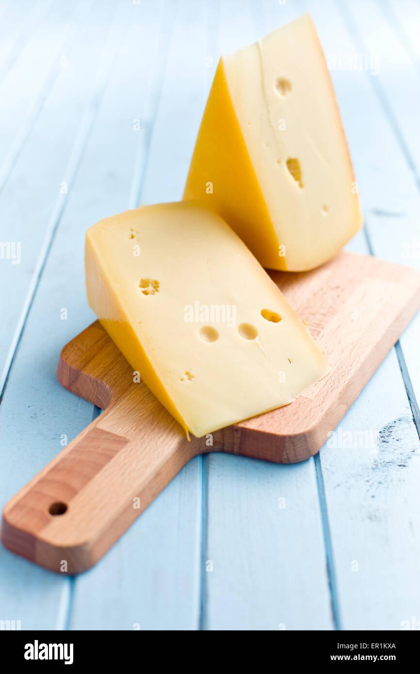 block of edam cheese on kitchen table - Stock Image