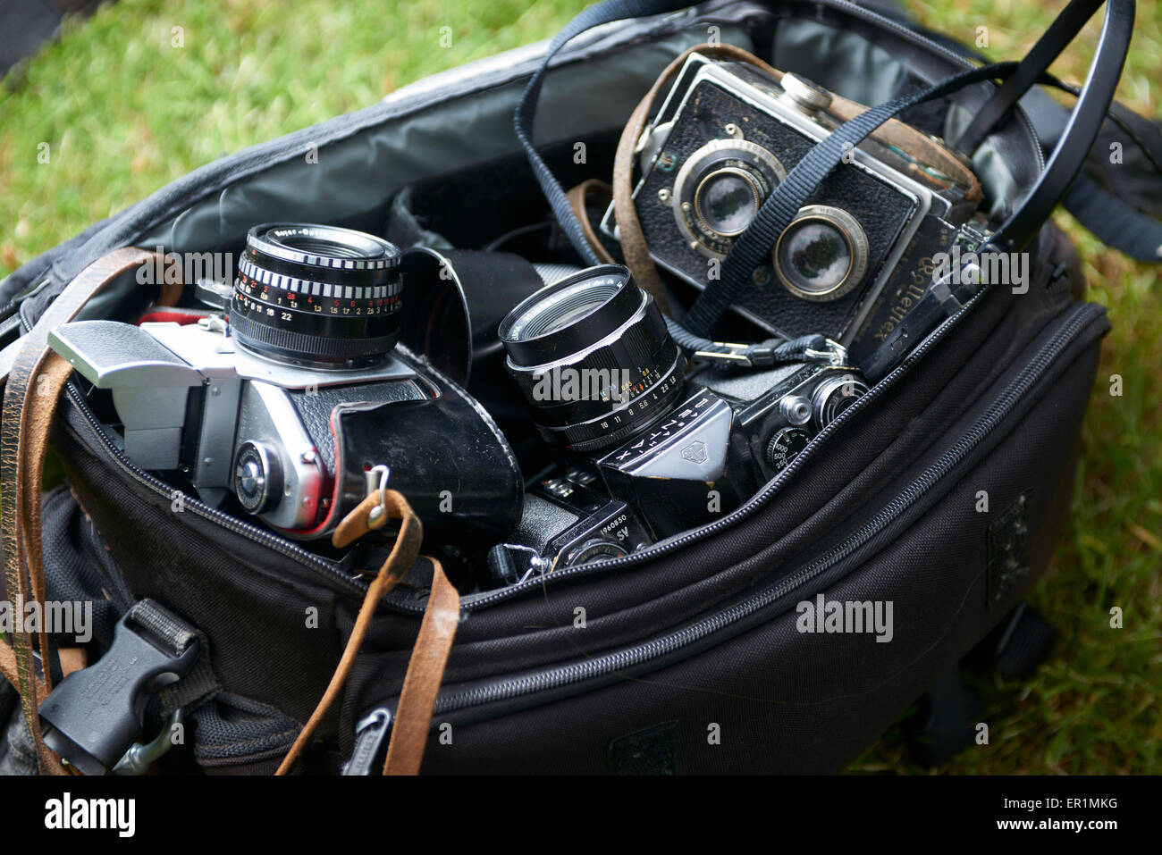 overhead image of group old vintage cameras gear needed for old school film photography enthusiasts - Stock Image