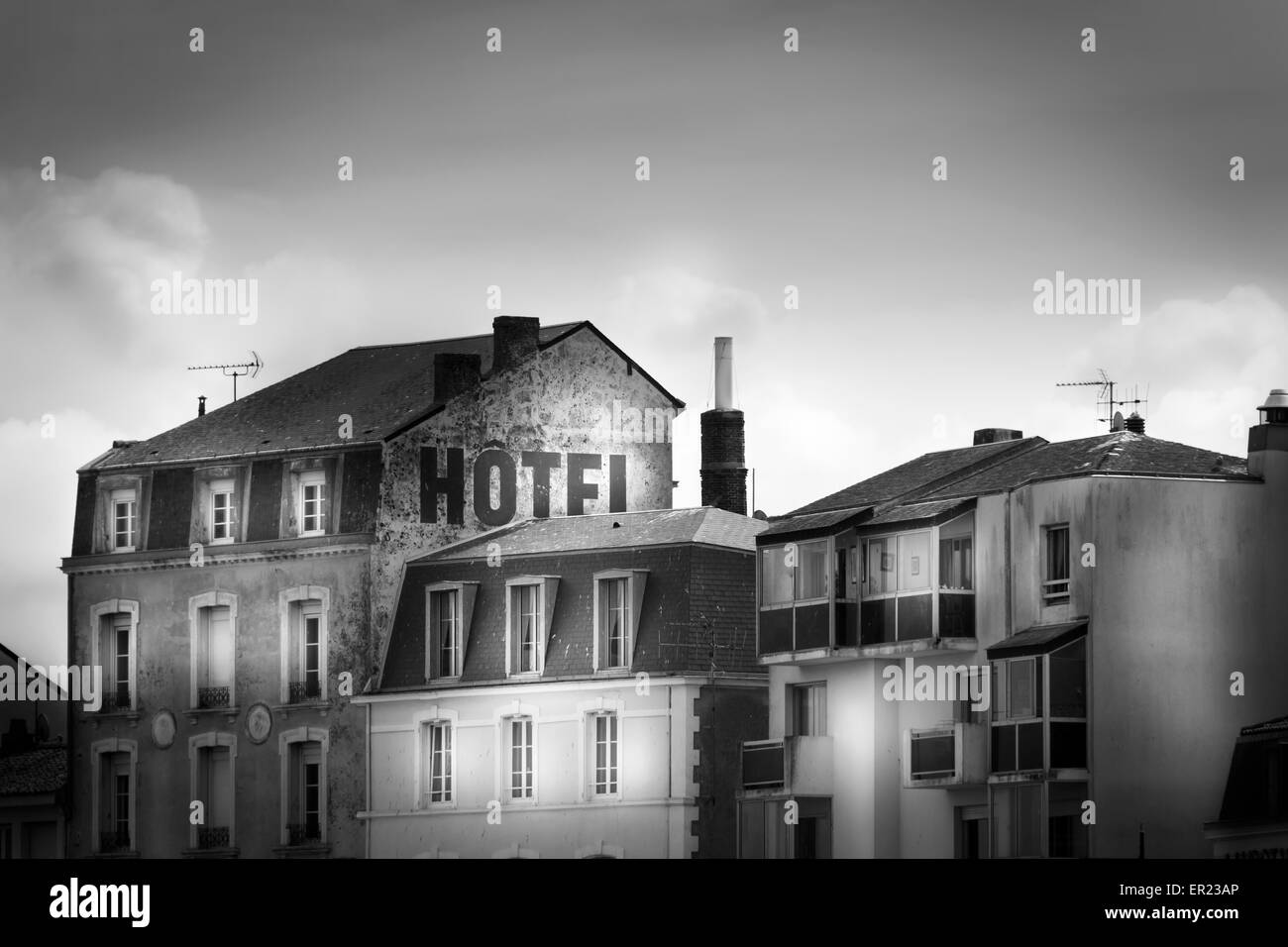 building exterior hotel facade old black and white - Stock Image