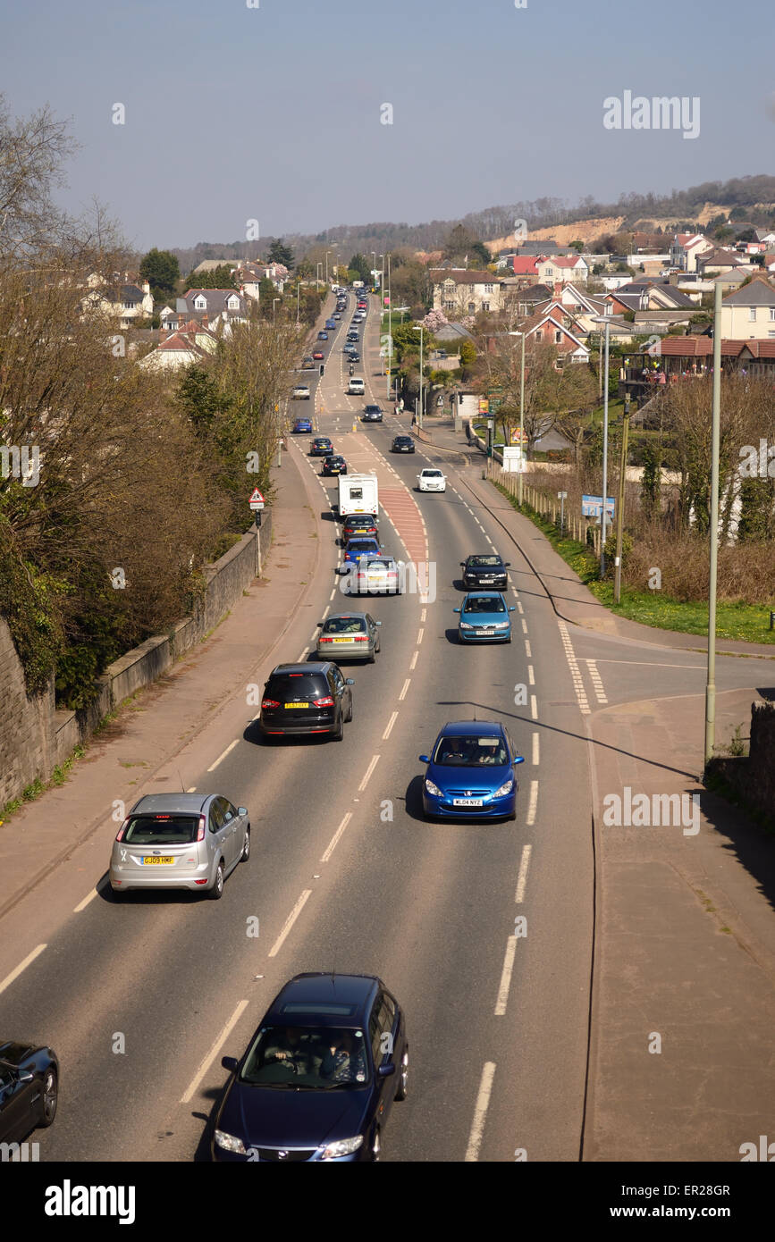 Traffic congestion along main road through village, awaiting completion of bypass. - Stock Image