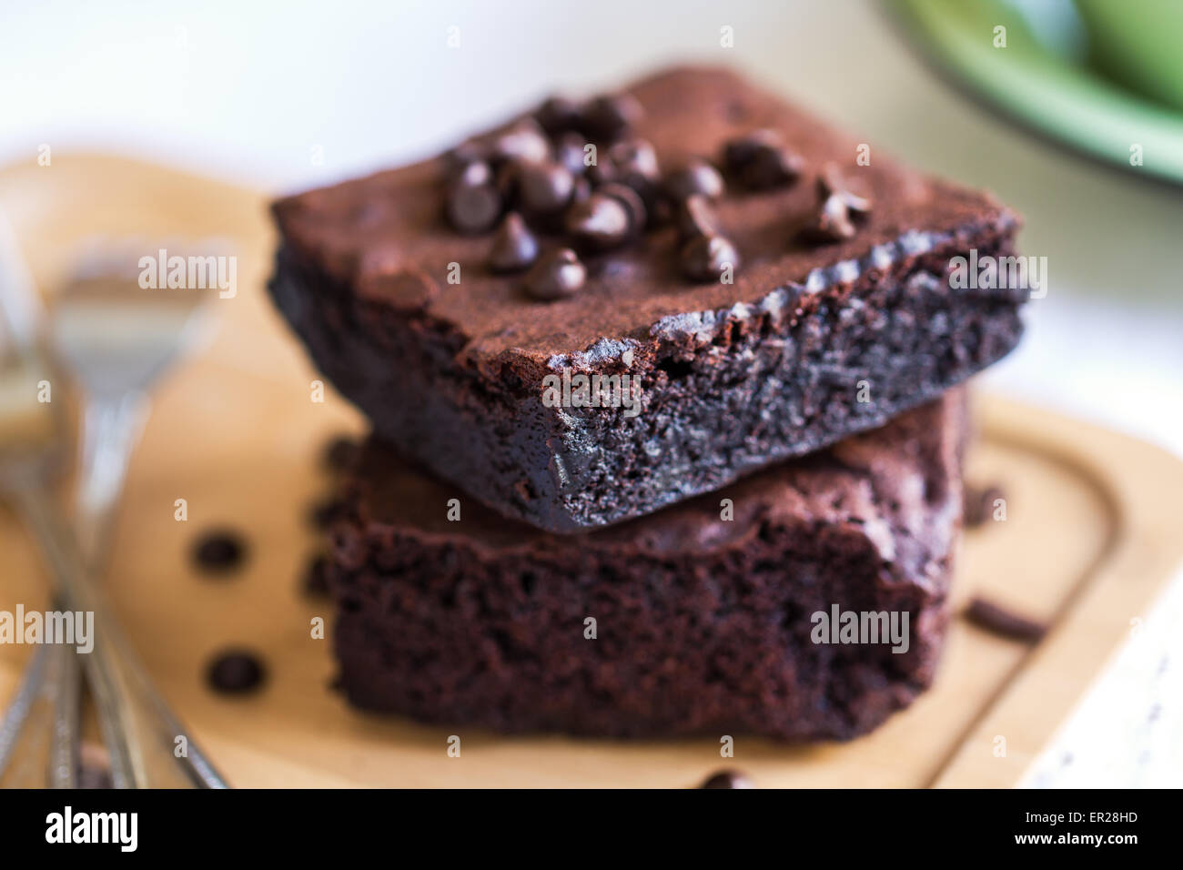 Homemade Brownies with chocolate chip by a cup of coffee - Stock Image