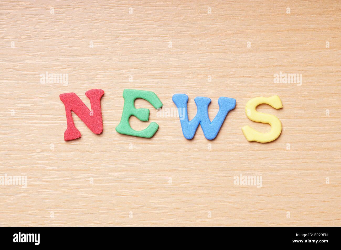 news in foam rubber letters Stock Photo