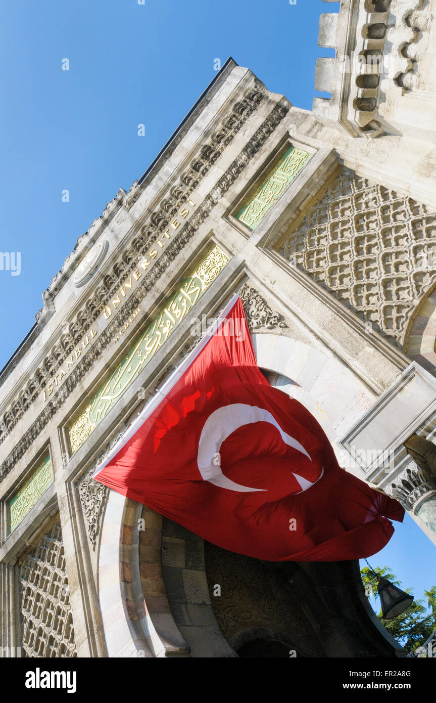 The national flag flies under the entrance to Istanbul University, Beyazıt Square, Istanbul, Turkey - Stock Image