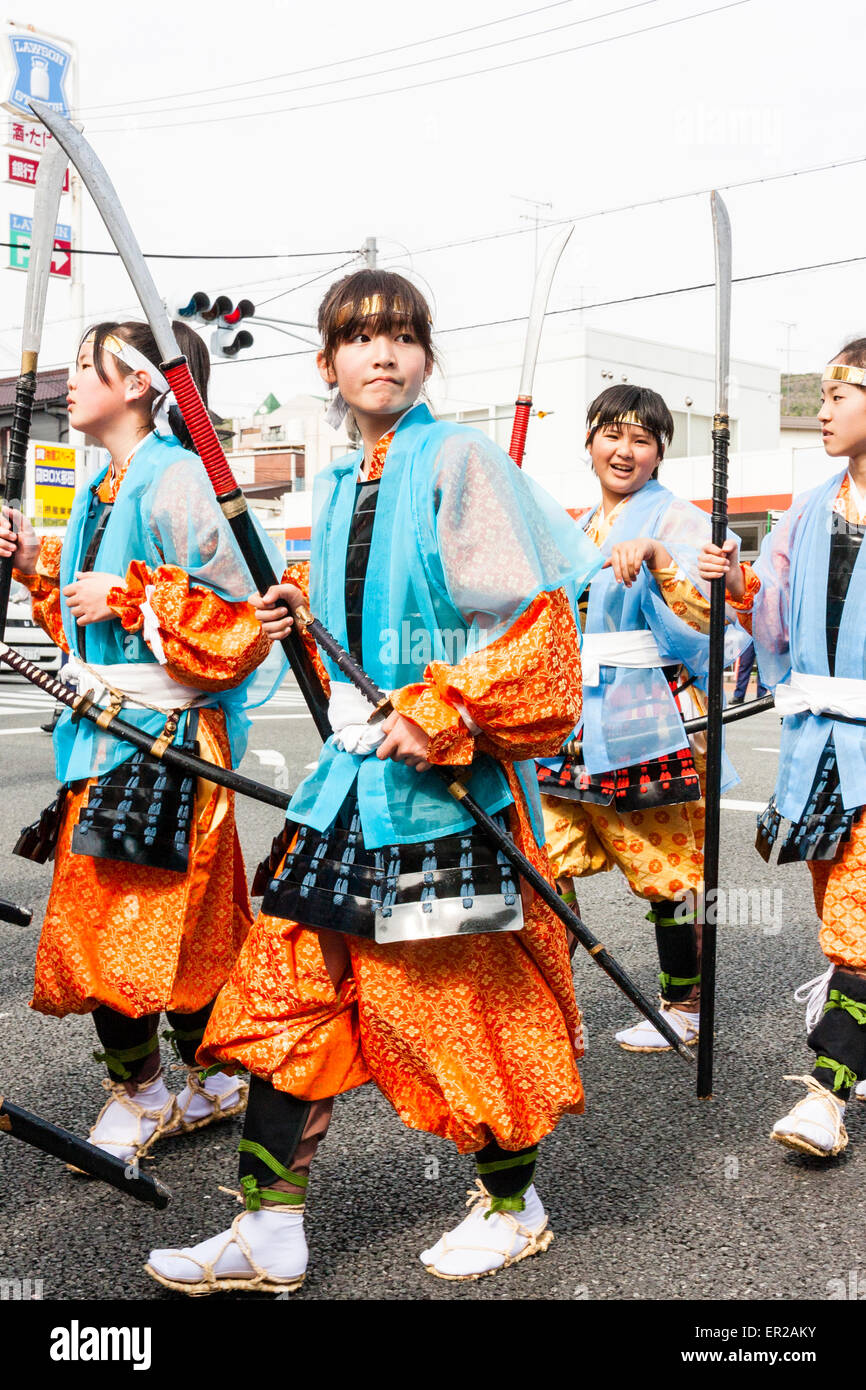 Japan, Kawanishi, Tada. Genji Festival. Girls, pre-teen, marching in procession, dressed as Heian period Ashigaru - Stock Image