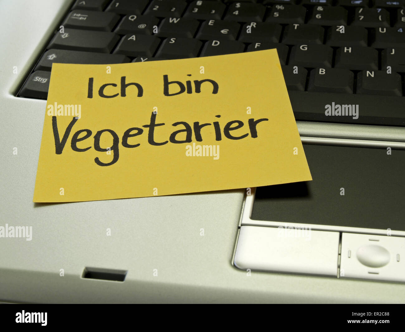 Memo note on notebook, I am a vegetarier - Stock Image