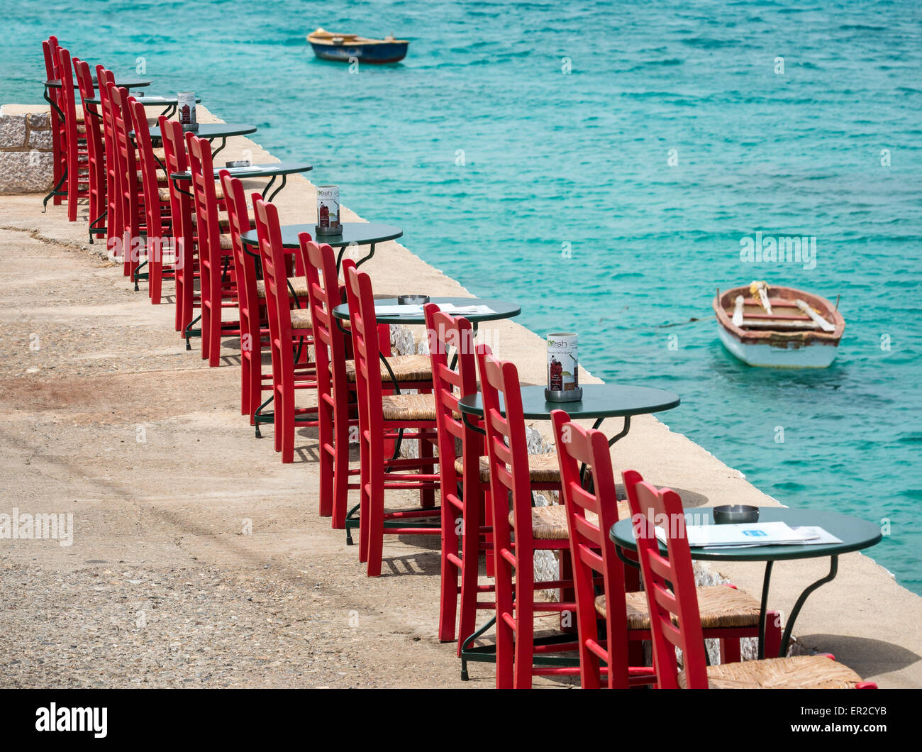 Taverna chairs in the little fishing village of Limeni in the Mani, Southern Peloponnese, Greece. - Stock Image