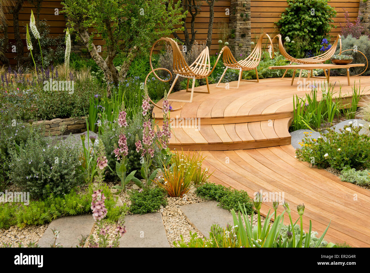 Curved Wooden Decking And Chairs Surrounded By Plants In The Royal